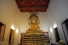 Ancient golden sitting Buddhas in Church of Wat Pho, Bangkok. stock image
