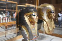 Ancient goldy Masks - Egyptian museum. Cairo, Egypt Jan. 2018 Ancient gold and silver antiquities - Egyptian museum Royalty Free Stock Photography