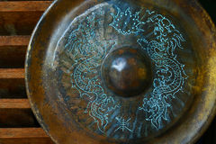 Ancient gong. Ancient chinese gong, with design of blue dragon Stock Image