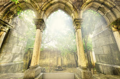 Ancient gothic arches in the myst. Fantasy landscape in Evora, Portugal. Ancient gothic arches in the myst. Fantasy landscape in Evora, Portugal Royalty Free Stock Photography