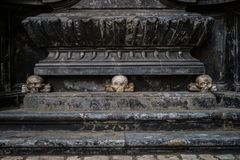 Ancient gothic church of Saint Mary in Krakow. Ancient Christian church of Saint Mary from Krakow city in Poland built in gothic style.Marble stone skull statue royalty free stock photos