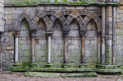 Ancient gothic stone wall Stock Photography