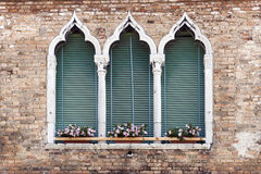 Ancient gothic style window in Venice royalty free stock photo