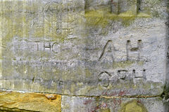 Ancient graffito. Ancient graffiti scratched into the stonework of an Elizabethan ruin Royalty Free Stock Photography