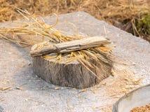 Ancient grain hand grinding wood stick Stock Photos