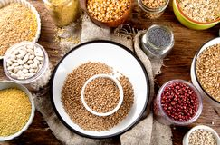 Ancient grains, seeds, beans. On wooden background. Top view Royalty Free Stock Photography
