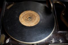 Ancient gramophone in the museum of antiques. Ancient gramophone with a plate in the museum of antiques stock photos