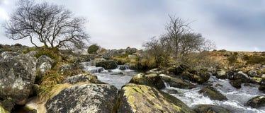 Walla Brook on Dartmoor. An ancient granite clapper bridge over Walla Brook near Scorhill on Dartmoor Stock Photos