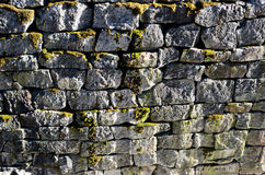 Ancient granite stone wall channel mossy Royalty Free Stock Photos