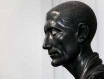 Ancient granitic bust of Gaius Julius Caesar stock photo