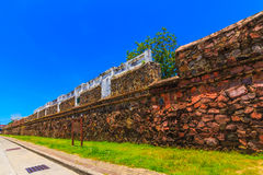 The ancient grate city wall. The ancient Songkhla city wall and blue sky Royalty Free Stock Photo