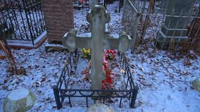 Ancient grave cross with artificial flowers stock video footage