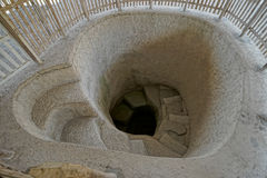 Ancient grave entrance in Colombia. Spiral stairs leading to pre-columbian underground grave in Tierradentro Colombia stock image