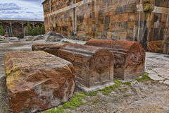 Ancient graves at temple walls i Stock Images