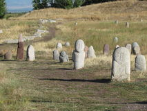 Ancient graveyard. Path through ancient graveyard in Kyrgyzstan Royalty Free Stock Photography