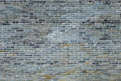 Ancient gray brick wall Stock Images