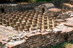 Ruins of Roman Odeion and Thermae in ancient Greece city Dion. Archaeological park of sacred city of Macedon. Ancient Greece city Dion. Ruins of Roman Odeion and stock photo