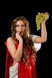 Ancient greece woman with a bunch of grapes Royalty Free Stock Images