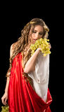 Ancient greece woman with a bunch of grapes Royalty Free Stock Photography