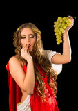Ancient greece woman hands a bunch of grapes Royalty Free Stock Photos