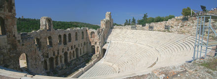 Ancient Greek Amphitheater. Panorama of Ancient Greek Amphitheater, Acropolis, Athens. Blue sky royalty free stock photography