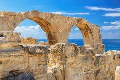 Ancient greek arches ruin city of Kourion near Limassol, Cyprus. Ancient Greek arches against the sea, Kourion near Limassol, Cyprus Royalty Free Stock Photos