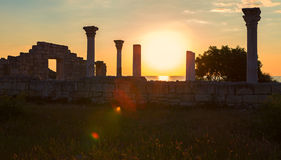 Ancient Greek basilica and marble columns in Chersonesus Taurica on the sunset background. Royalty Free Stock Photography