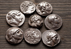 Ancient greek coins on a wooden table Royalty Free Stock Photos