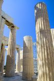 Ancient Greek Columns. With doric tops. Blue sky royalty free stock photo