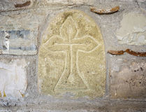Ancient Greek Cross on the Stone Wall Royalty Free Stock Photography