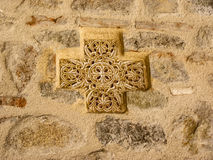 Ancient Greek Cross on the Stone Wall Stock Photo