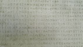 Ancient Greek letters on stone Royalty Free Stock Image
