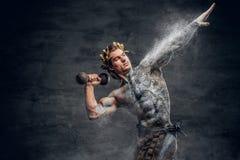 Ancient Greek male sportsmen holds dumbbell. Crumbling statue - Ancient Greek male sportsmen holds dumbbell Royalty Free Stock Images