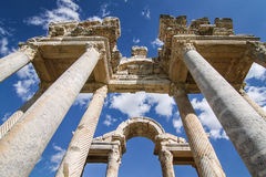 Ancient Greek Monument. Artistic view of ancient Greek monument with blue sky and clouds in background Stock Photo