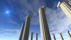 Ancient greek pillars built in a round. A 3D rendered image of ancient greek columns. You see white marble pillars build in a round. A sunny blue sky at the Stock Photography