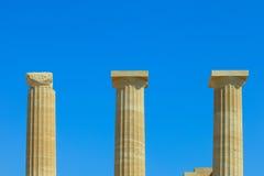 Ancient greek pillars at top of Lindos Acropolis Royalty Free Stock Photo