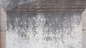Ancient Greek script carved on stone plate, Patara,Turkey stock video