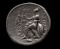 Ancient greek silver coin  on black Royalty Free Stock Photos