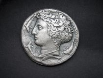Ancient Greek silver coin from Syracuse stock photos