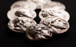 Ancient greek silver coins closeup macro shot Stock Image