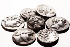 Ancient greek silver coins closeup macro shot Royalty Free Stock Images