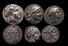 Ancient greek silver coins with portraits of rulers and gods Royalty Free Stock Photos