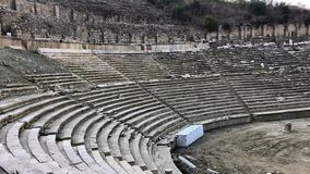 Ancient Greek Stadium in Magnesia Aydin Province, Turkey. Panoramic view from the spectators stand to the tribunes, running track and ruins of starting line stock video