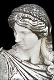 Ancient Greek statue. Statue on black background showing a greek mythical muse Royalty Free Stock Photo