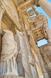 Ancient greek statue in building facade Stock Images
