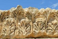 Greek Corinthian order foliage stone ornament. Greek stone Corinthian order style foliage ornament on the citadel of Amman, Jordan Stock Photo