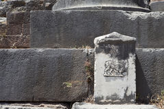 Ancient Greek Tablet. Ancient Greek writing on a tablet in Delphi, Greece. Carved minotaur on a white marble Royalty Free Stock Photography