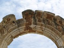 Ancient greek temple bow. Bow from the Hadrianus temple depicting Medusa, Ephesus, Turkey Stock Photos