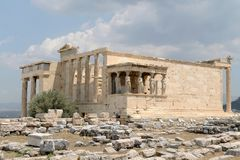 Erechtheion, AThens, Greece ancient temple. Ancient Greek Temple, the Erechtheion, in Athens and the ruins around it.  Dedicated to Athena and Poseidon Royalty Free Stock Photo