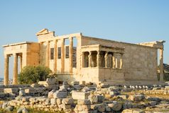 Ancient Greek Temple of the Erechtheum. Ancient Greek Temple of the Erechtheum on Acropolis at sunset Royalty Free Stock Photo